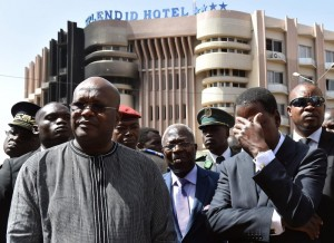 """Burkina Faso's President Roch Marc Christian Kabore (L) and Benin's President Thomas Boni Yayi (R) visit the Splendid hotel and the Capuccino cafe on January 18, 2016 in Ouagadougou, following a jihadist attack by Al-Qaeda in the Islamic Maghreb (AQIM) late on January 15. West African nations will """"fight back"""" after a Burkina Faso hotel attack that left 29 dead and showed jihadist fighters expanding their reach in the region, Benin President Thomas Boni Yayi said on January 18, 2016. Friday's attack on a four-star hotel, which left at least 29 dead, half of them foreigners, came weeks after an attack on a luxury Mali hotel in Bamako claimed by Islamists that left 20 people dead. / AFP / ISSOUF SANOGOISSOUF SANOGO/AFP/Getty Images"""