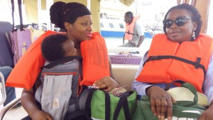 Leaving Sierra Leone with my son. Sitting next to me is former parliamentarian newly appointed Minister of State Isata Kabia. Ms. Kabia sponsored the right to abortion bill that was passed in parliament but that got sent back by the President after giving in to pressures from a male dominated assembly of religious leaders. Photo Credit: Go Woman Africa