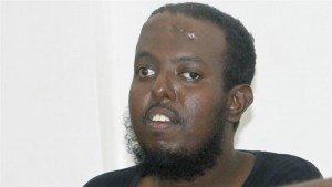 Hanafi said he confessed to the killing of journalists following torture by authorities in Mogadishu [AP]